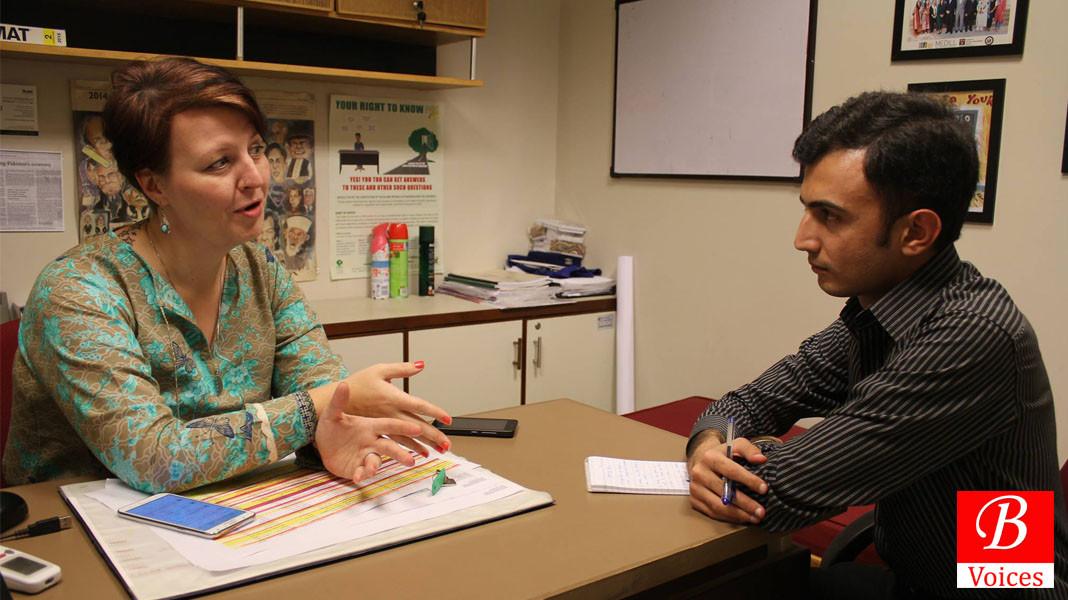 Christie Lauder with Adnan Aamir during interview